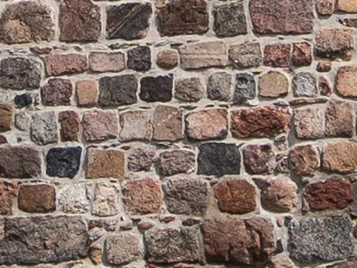 Exakte Quaderung der Feldsteine an der Westwand der Kapelle